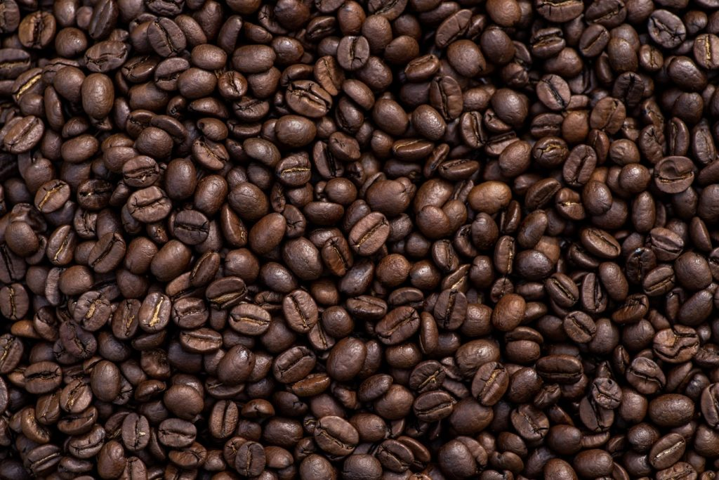Arabica vs Robusta coffee: Arabica coffee beans on a container
